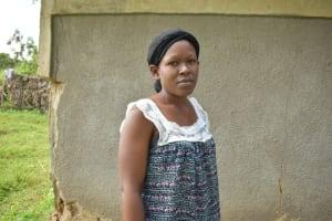 The Water Project: Makhwabuye Community, Majimazuri Lusala Spring -  Shelmith Outside Her Home