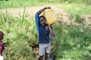 The Water Project: Mukangu Community, Mukasia Spring -  Carrying Water From Mukasia Spring