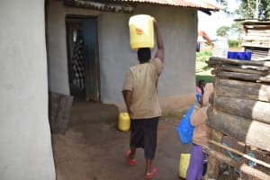 The Water Project: Kimang'eti Community, Kimang'eti Spring -  Agnes Arriving Home With Water