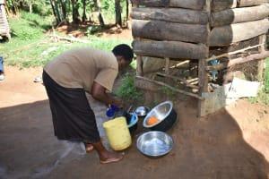 The Water Project: Kimang'eti Community, Kimang'eti Spring -  Agnes Washing Dishes