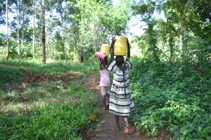 The Water Project: Kimang'eti Community, Kimang'eti Spring -  Girls Carrying Water