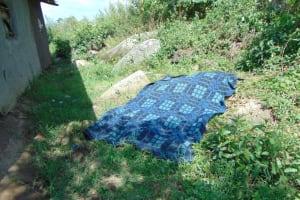 The Water Project: Bukhakunga Community, Wakukha Spring -  Blanket Drying On Ground