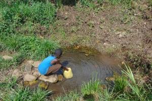 The Water Project: Bukhakunga Community, Wakukha Spring -  Boy Fetching Water