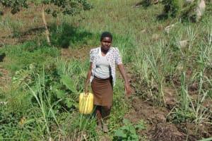 The Water Project: Bukhakunga Community, Wakukha Spring -  Carrying Water