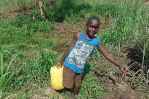 The Water Project: Bukhakunga Community, Wakukha Spring -  Child Carrying Water