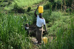 The Water Project: Indulusia Community, Wanyama Spring -  Mrs Wanyama Carrying Water