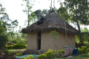 The Water Project: Indulusia Community, Wanyama Spring -  Repairing Roof On A Traditional Hut