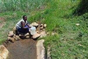 The Water Project: Bukhakunga Community, Maikuva Spring -  Fetching Water