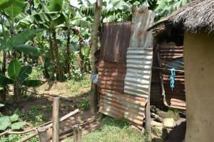 The Water Project: Shamoni Community, Shiundu Spring -  Bathroom Shelter
