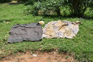 The Water Project: Shamoni Community, Shiundu Spring -  Clothes Drying On Ground