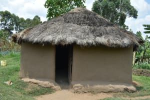 The Water Project: Shamoni Community, Shiundu Spring -  Grass Thatched House