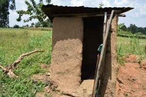 The Water Project: Shamoni Community, Shiundu Spring -  Mud Walled Latrine