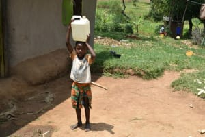 The Water Project: Shamoni Community, Shiundu Spring -  Arriving Home With Water