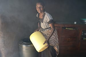 The Water Project: Makhwabuyu Community, Sayia Spring -  Pouring Water Into A Storage Container