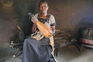 The Water Project: Makhwabuyu Community, Sayia Spring -  Preparing Milk