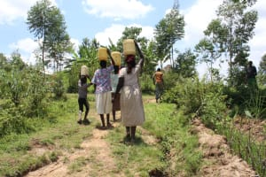 The Water Project: Mayuge Community, Ucheka Spring -  Carrying Water