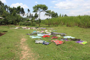 The Water Project: Mayuge Community, Ucheka Spring -  Cloths Drying On Ground