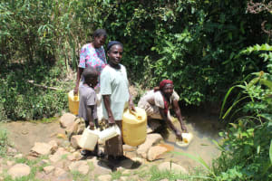 The Water Project: Mayuge Community, Ucheka Spring -  Fetching Water