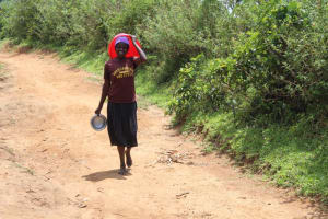 The Water Project: Mayuge Community, Ucheka Spring -  On Her Way To Fetch Water