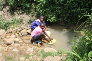 The Water Project: Mayuge Community, Ucheka Spring -  Students Fetching Water