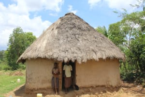 The Water Project: Mayuge Community, Ucheka Spring -  In Front Of Their Traditional Household