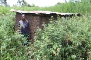 The Water Project: Mayuge Community, Ucheka Spring -  Outside Her Latrine