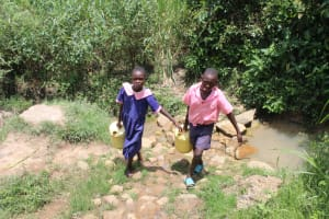 The Water Project: Mayuge Community, Ucheka Spring -  Students Carrying Water