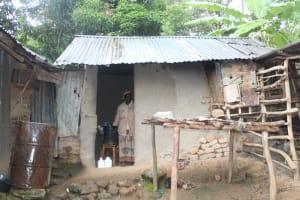The Water Project: Shibikhwa Community, Musotsi Spring -  A Rainwater Tank Outside A Kitchen