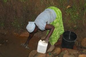 The Water Project: Shibikhwa Community, Musotsi Spring -  Fetching Water