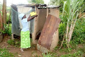 The Water Project: Shibikhwa Community, Musotsi Spring -  Irene Handwashing Outside Her Latrine