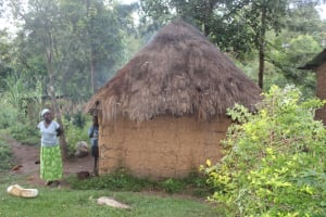 The Water Project: Shibikhwa Community, Musotsi Spring -  Irene Outside Her Kitchen