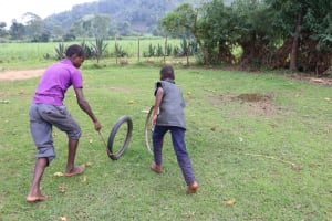 The Water Project: Mukhuyu Community, Gideon Kakai Chelagat Spring -  Children Racing Their Cars
