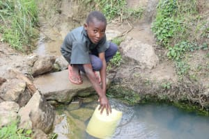The Water Project: Mukhuyu Community, Gideon Kakai Chelagat Spring -  Collecting Water