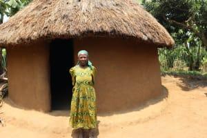 The Water Project: Mukhuyu Community, Gideon Kakai Chelagat Spring -  Madam Kakai Outside Her Hut