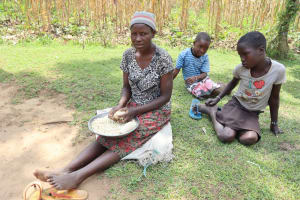 The Water Project: Mukhuyu Community, Gideon Kakai Chelagat Spring -  Betty Hand Shelling Maize