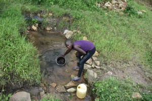 The Water Project: Makale Community, Kwalukhayiro Spring -  Collecting Water