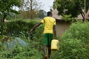 The Water Project: Wepika Community, Musa Mmasi Shikwe Spring -  Carrying Water