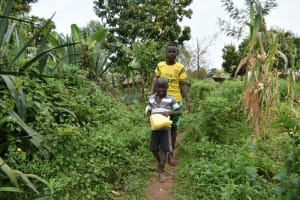 The Water Project: Wepika Community, Musa Mmasi Shikwe Spring -  Heading To Fetch Water