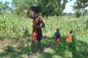 The Water Project: Lunyinya Community, Makunga Spring -  Carrying Water From The Spring
