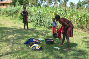 The Water Project: Lunyinya Community, Makunga Spring -  Children Washing Clothes Near The Spring