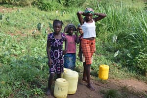 The Water Project: Lunyinya Community, Makunga Spring -  Children Waiting To Fetch Water