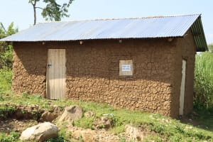 The Water Project: Mwera Community, Mukunga Spring -  House With Physical Distancing Reminder On Window