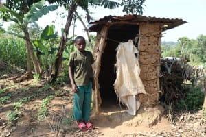 The Water Project: Mwera Community, Mukunga Spring -  A Boy Next To A Latrine