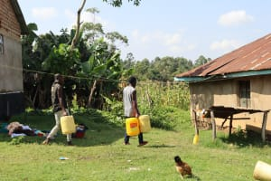 The Water Project: Mwera Community, Mukunga Spring -  Carrying Water Home