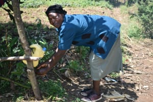 The Water Project: Makunga Community, Tabarachi Spring -  Agnes Washing Her Hands Using A Leaky Tin