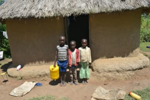 The Water Project: Makunga Community, Tabarachi Spring -  Children Outside A Kitchen
