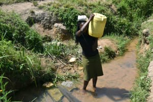 The Water Project: Makunga Community, Tabarachi Spring -  Mounting Water On Her Head To Carry