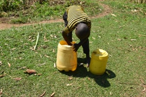The Water Project: Makunga Community, Tabarachi Spring -  Cleaning Water Storage Container