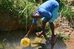 The Water Project: Makunga Community, Tabarachi Spring -  Fetching Water