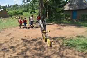 The Water Project: Makunga Community, Tabarachi Spring -  Playing With Homemade Motorcycle Using Poles And Plastic Lids